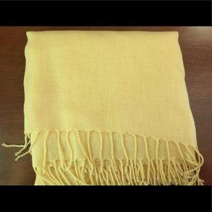 Pale yellow shawl.